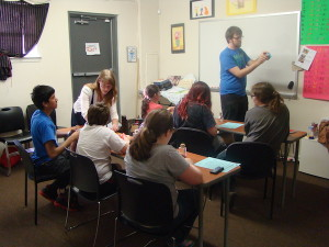Young adult leaders run a class for youth.