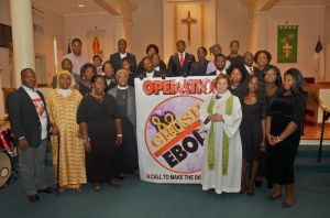 Bishop Burkat and Pr. Pat Davenport with members of the Liberian Community.