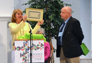 """Susan MacPherson (left), with husband Tom, displays a """"welcome home"""" gift."""