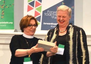 Bishop Burkat presents Susan Pursch with a gift honoring her service to our SEKOMU partnership.