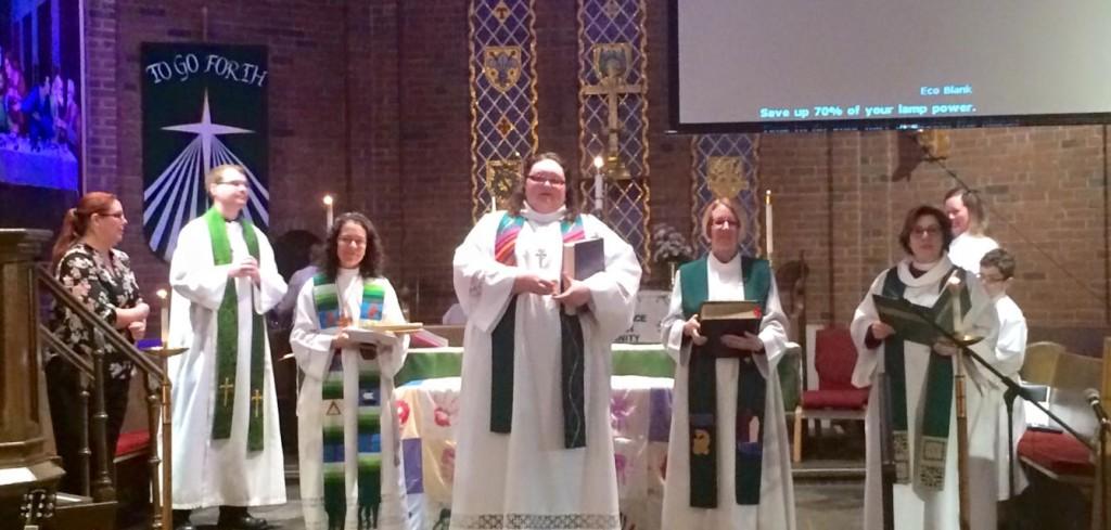 Vested, from left, Pastors Krey, Neale, Heiserer, Emmert and Bishop Burkat.