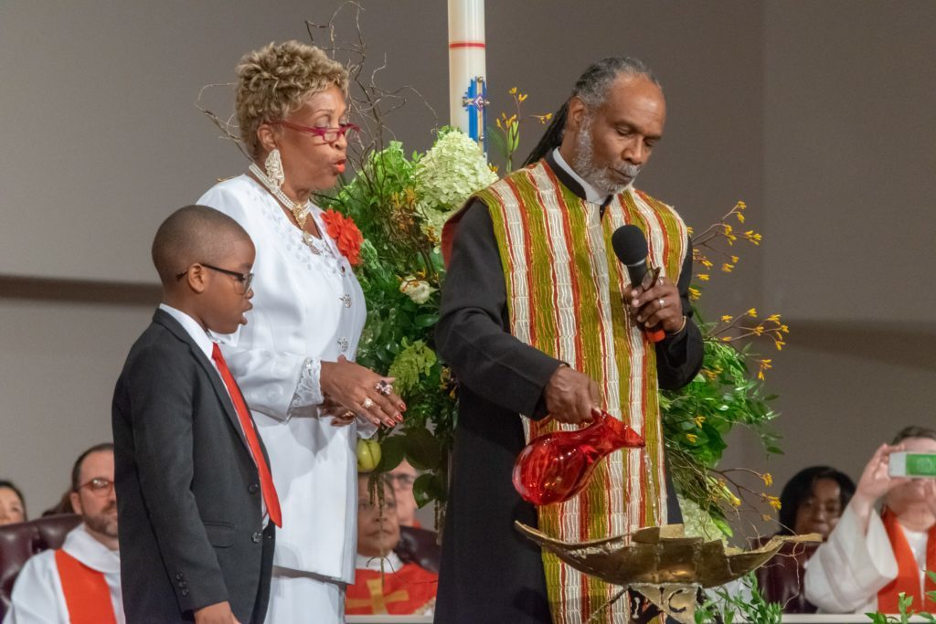 The Rev. Dr. Albert Starr Jr. Leads the pouring of libations, a traditional African ritual honoring and inviting community ancestors to be present at the celebration.