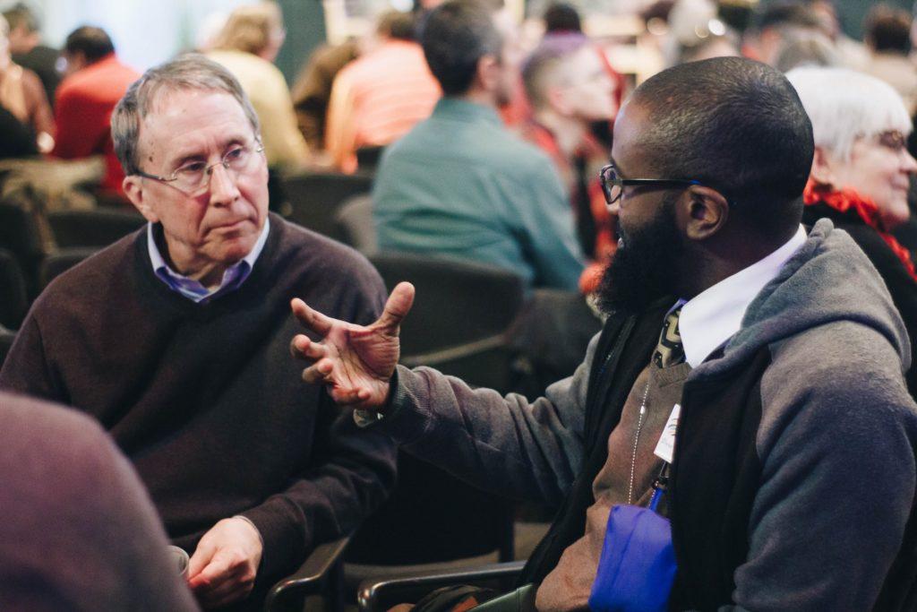 Pastor Stephen Keiser of Christ, Upper Darby, engaged in conversation.